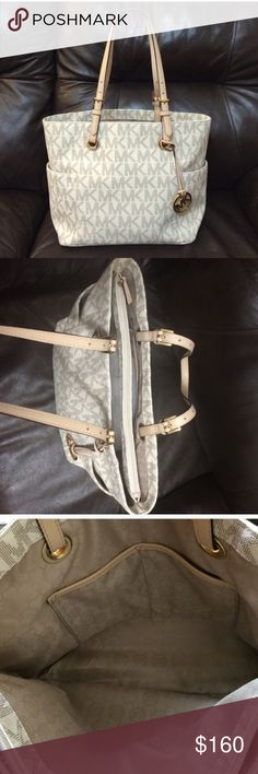 Authentic MK large cream tote pure Authentic ! its in really great like new condition . No dust bag size left-right 16.5 in top-bottom 10.5in strap length 9.5 in Michael Kors Bags