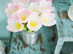 Budget-friendly and refreshing, vase flower arrangements are great additions to any style room.