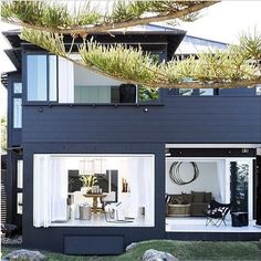 """This Sydney beach house is decorated with a beautiful minimalist style that proves that many times """"less is more"""". The navy blue exterior of this house is Exterior House Colors, Exterior Design, Grey Exterior, Turbulence Deco, Beach Shack, Facade House, Coastal Homes, Beach Cottages, Beach House Decor"""