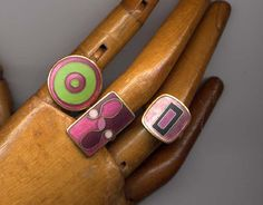 "French vs. German Modernist Enamel Jewelry- German matte enamel rings by Scholtz & Lammel. The enamelled copper rings all have adjustable shanks with ""S"" in a circle stamped on the counter-enamel."