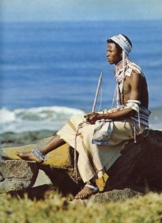 """Young man in full beadwork dress., possibly from the Ngqika tribe. Image included in the publication """"African Elegance"""" by Alice Mertens & Joan Broster. Published by Purnell in"""