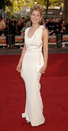 Pin for Later: From Bond Girl to Gone Girl: Rosamund Pike's Red Carpet Evolution Rosamund Pike Rosamund picked a white grecian-inspired gown for the 2007 GQ Men of the Year Awards in London.