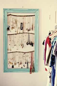 jewelry hanger: painted picture frame with sticks (and I'm guessing some sort of pins or nails to hold up the necklaces) --- this is a fantastic idea!