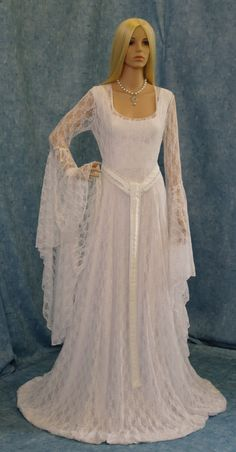Galadriel white lace dress LOTR hobbit Renaissance medieval handfasting  wedding custom made. $398.00, via Etsy.Since my main color will be red, maybe use a red sash of sorts instead of the rope, and maybe touch up the sleeves (possibly make them shorter).