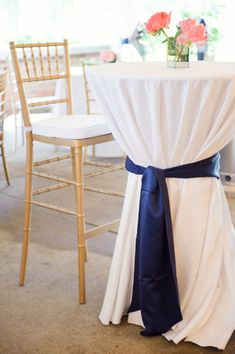 cocktail tables...we could do something like this (colored ribbon w/white table cloths on all the tables) if renting our own linens gets too expensive