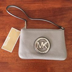 Michael Kors Fulton Pearl Grey wristlet Brand new with tags! Light pearl grey with interior card slots. Gorgeous soft pebbled leather. Can fit a large phone inside. Michael Kors Bags Clutches & Wristlets