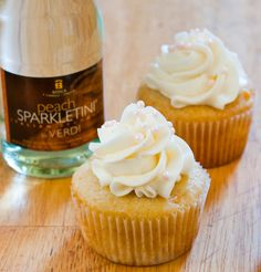 Peach Bellini Cupcakes - a classic brunch cocktail turned cupcake. Fluffy peach cupcakes topped with tangy champagne buttercream.