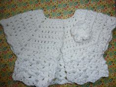 Crochet baby cardigan or sweater with flower