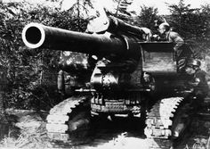 """""""We mean business!"""" A Russian gun manned is ready for action somewhere on the Russian front. September 15, 1941."""