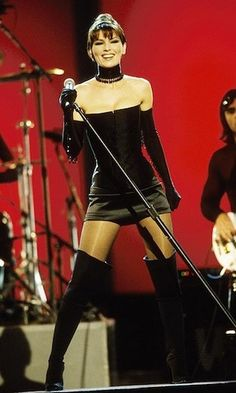 """In one of her most memorable performances to date, Shania brought down the house at the 1999 Grammys with a show-stopping rendition of """"Man, I Feel Like a Woman,"""" sporting sexy short shorts, a corset and thigh-high boots. Photo © Kevin Mazur/WireImage/G Leopard Print Bra, Leopard Print Outfits, Country Music Awards, Country Singers, Shania Twain Pictures, Singer One, Jenifer Aniston, Sexy Shorts, Short Shorts"""