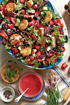 Recipe: Strawberry Salad with Warm Goat Cheese Croutons  To prepare the goat cheese croutons, cut a goat cheese log into rounds. Press each round to 1/2-inch thickness on a baking sheet and freeze for 20 minutes. this process will help the rounds keep their shape and not ooze out of their breading while frying. Serve the salad with Strawberry-Poppy Seed Vinaigrette.