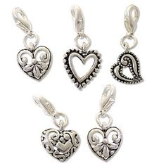 These 5-piece charm sets are great for accenting purses or zipper pulls!
