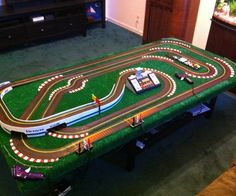 So you have a bunch of slot car track, its a fun little hobby, fast challenging and relatively cheap. In this instructable, I show you how I took a pile of track and a door and made it into a great looking raceway that can be set up in a few moments Its a technical track for the racers having high speed straits and tight curves. Its also a good track for the non magnetic cars, it has skids around the curves to make the outside lanes more like the inside lanes. This track h...