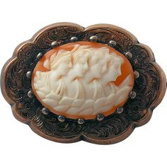 Victorian cameo brooch pin Four Seasons Maidens features hand carved sardonic shell depicting four lovely maidens in profile who represent the four