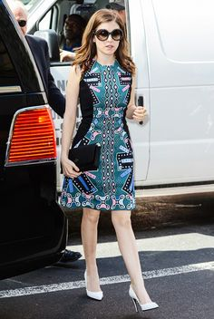 Anna Kendrick wears a printed Peter Pilotto shift dress, Kate Space black clutch, and studded white pumps