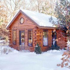 Log home cabin with big windows.