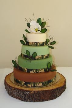 Camo trimmed wedding cake with a sugar magnolia flower.