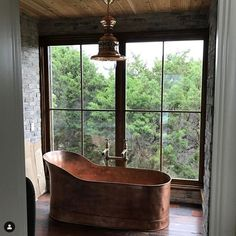 Copper soaking tub in front of large window Copper Tub, Copper Bathroom, Boho Bathroom, Bathroom Sinks, Bathroom Inspo, Modern Bathroom, Master Bathroom, Rustic Bathrooms, Large Windows