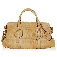 Prada Golden Beige Ruched Bag http://www.consignofthetimes.com/product_details.asp?galleryid=6854