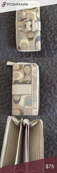 Coach wallet Coach zip around wallet.  Contains plenty of room for credit cards, cash, cellphone, etc.  Plus size IPhone fits. Coach Bags Wallets