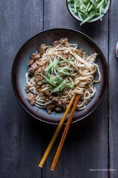 Zha Jiang Mian (Noodles in bean sauce). Noodles are smothered in meat sauce made of ground/minced meat with Chinese black bean sauce (Zha Jiang) and topped with refreshing shreds of cucumber