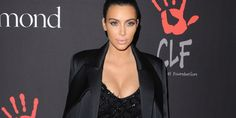Kim Kardashian, we're really not sure about your weird glitzy fishnet dress -Sugarscape.com