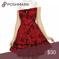 Red & Black Flocked Skull Dress Red and black dress with flocked filigree, skulls, and black lace at the hem. Hot Topic Dresses Mini