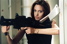 Smith publicity stills and other photos. Featuring Angelina Jolie, Brad Pitt, Adam Brody, Kerry Washington and others. Sr Y Sra Smith, Ms Smith, Angelina Jolie Fotos, Angelina Jolie Smoking, Angelina Joile, Mr And Mrs Smith, Julie Andrews, Stana Katic, Julia Roberts