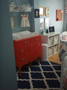 love the red dresser on blue wall