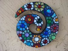 Stained glass and glass gem mosaic.  Way fun.  I sold it!