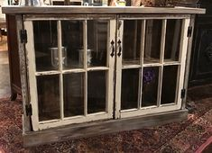 A farm piece window cabinet made from old windows and reclaimed wood decora Antique Windows, Vintage Windows, Old Windows, Window Furniture, Cabinet Furniture, Repurposed Furniture, Vintage Furniture, Repurposed Shutters, Furniture Projects