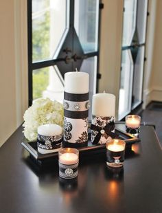 Damask print paper on pillars and votives. Love this