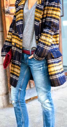Street style plaid warm blazer, distressed jeans and sweater shirt