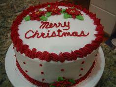 "8"" Red Velvet Cake with buttercream icing.  Buttercream Poinsettia's on top and one on bottom border.  Tip 18 and 104 top border, tip 3 dots on sides with tip 18 star bottom border.  Perfect Christmas dessert."