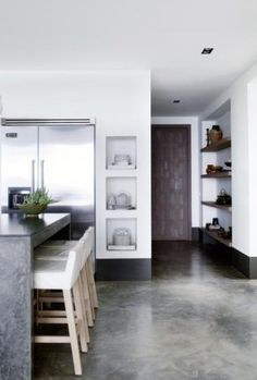 *waterfall soapstone island.  Built in shelves with light low back stools! love