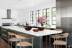 Suede barstools surround the edge of the island in this Bel Air, California, kitchen decorated by Waldo Fernandez of Waldo's Designs.
