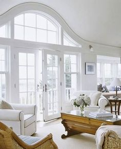 Love the curved arch over the French Door