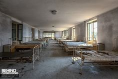 Red Cross Hospital, Italy - Rows of beds in dormitory Abandoned Hospital, Hospital Room, Old Beds, Building Art, Dormitory, Metal Beds, Red Cross, Closed Doors, Abandoned Places