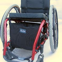 The Wheelchair Just A Sac attaches with Side Release Adapt A Strap System (SR-ADST) to the push handles for quick bag release and reattachment. Strap webbing adjusts to fit a wide range of wheelchair