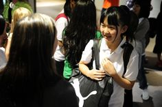 Nanami Watanabe, 15, of Fujiyoshida, Japan, is greeted by American students and faculty during a cultural exchange Aug. 7 at Skyview Middle School in Falcon School District 49. Nearly 20 of the school's eighth graders welcomed 17 students from junior high schools in Fujiyoshida. The Mount Fuji community formed a sister city relationship with Colorado Springs in 1962. This year, social studies teacher Gary Heaston helped connect students from both countries within a public school.