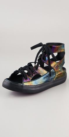 There is something so cool about these. Iridescent patent leather cut out sneakers, mmmmmmmmmm
