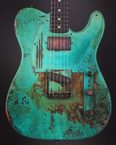 James Trussart Guitars Titanic Green Roses SteelCaster. Plain Back. Roses engraved Top and Headcap. Arcane Inc.Tele Bridge and Neck Humbucker.