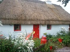Irish Thatched Cottages in Ireland | cottage with its red door in Currabinny, Co. Cork Ireland ...