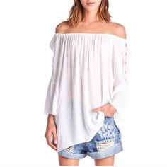White Off The Shoulder Top Super cute white off the shoulder bell sleeve top.  Crochet detail to sleeves. Just adorable!   ✨Loose fit & flowy. Only medium available but can also fit large. ✨Made in USA Tops