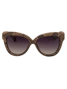 LINDA FARROW - Gator shades...well actually snakeskin- funny how these things have suddenly become interchangable - croco for snake, etc. Like no one knows the difference anymore- one animal is the same as the next...
