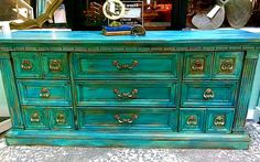 This stunning dresser was created by one of our local artists! Gorgeous shades of blues and greens...