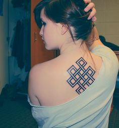 Buddhist endless knot tattoo.  THISSS!!! (but smaller lol)