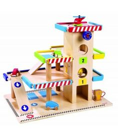 Lovely wooden toy garage complete with vehicles and helicopter #woodentoys #toygarage