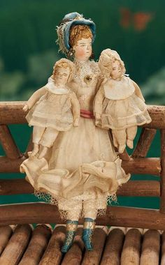 """Early Miniature cloth family of mother and two babies in original costumes - 5 1/2"""""""