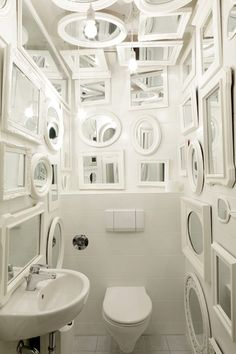 "A mirrored bathroom by German firm Tulp Design that plays on ideas of ""vanity"" (even the ceiling is covered in framed mirrors!). While the mirrored bathroom is hardly a new idea, the mix of frames and shapes in this room—unified visually with a coat of white high-gloss paint—keeps it fresh and distinctive."